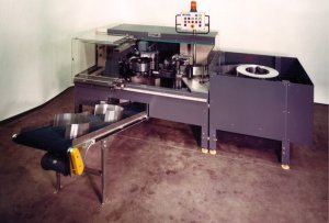 Type 329 machine for the automatic production of sheet metal rings with closure clamps